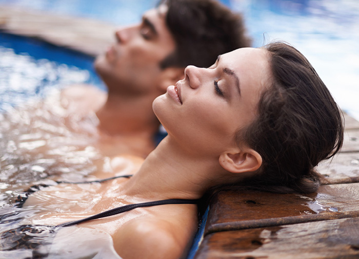 Couple laying out by the pool