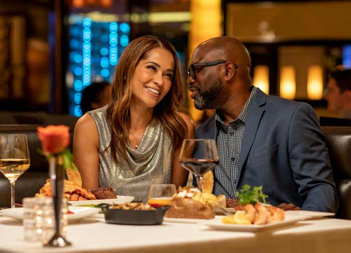 Couple eating at Atlantis Steakhouse