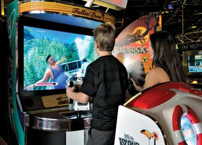 Pre-teens playing arcade games at Atlantis Fun Center