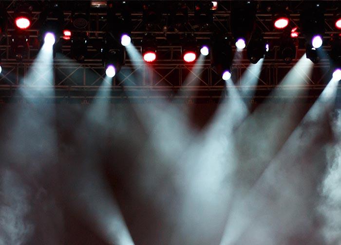 Stage lights shining through thick smoke