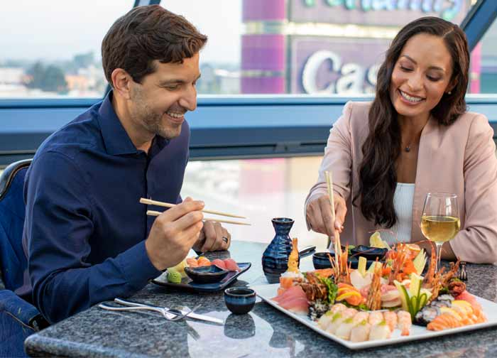 Couple eating sushi platter at Atlantis