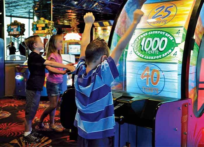 Kid playing games at Atlantis