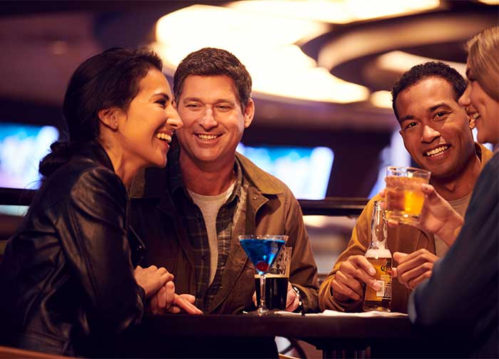 Group having drinks at Sports Bar & Lounge