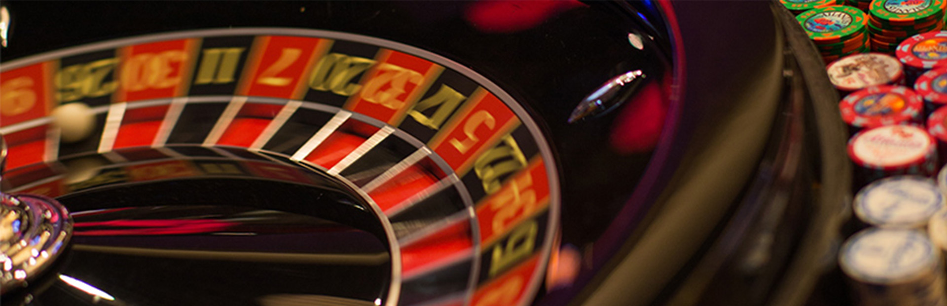 Close-up of roulette wheel and betting chips