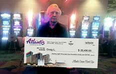 Jackpot winner Craig L. holding a check