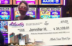 Jackpot winner Jennifer H. holding a check