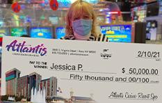 Jackpot winner Jessica P. holding a check