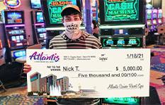 Jackpot winner Nick T. holding a check