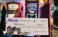Jackpot winner Paula K. holding a check