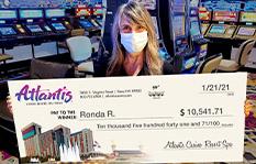 Jackpot winner Ronda R. holding a check
